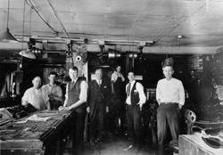 1920 H. C. Paddock stands with employees in the Daily Herald office building